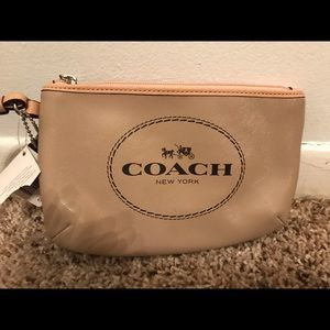 Authentic Coach wristlet brand new with tag